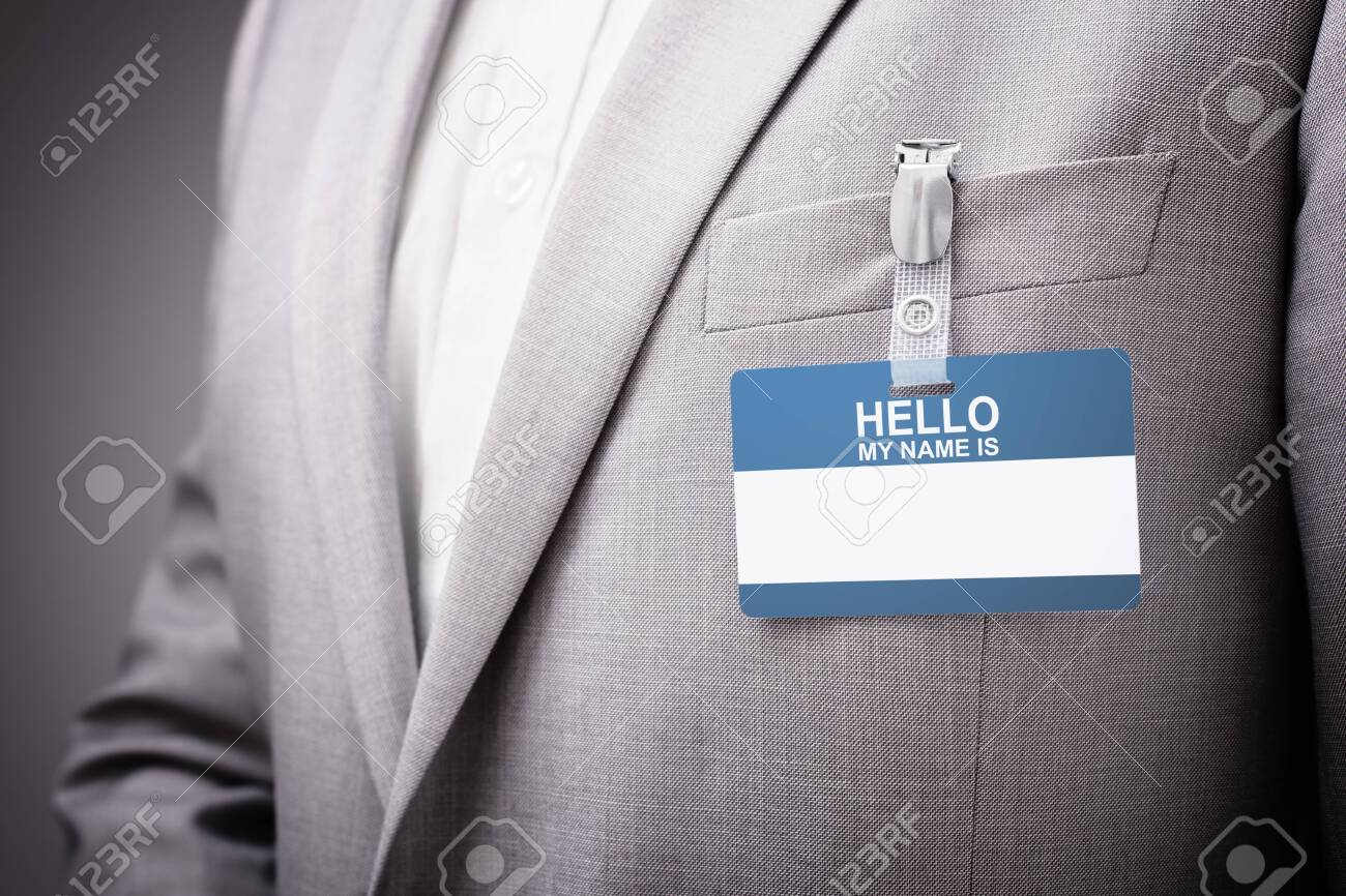 Businessman at an exhibition or conference wearing a Hello my name is security identity name card or tag - 131759891