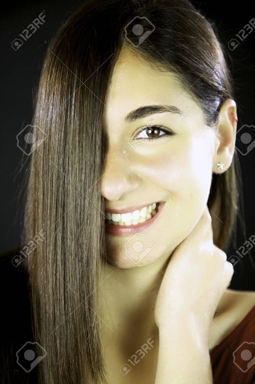 Young woman with gorgeous smile and amazing long straight hair Stock Photo - 13647264