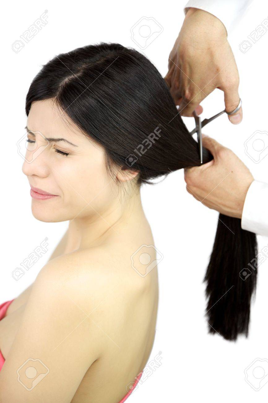 Very scared female model because of big haircut Stock Photo - 14403116
