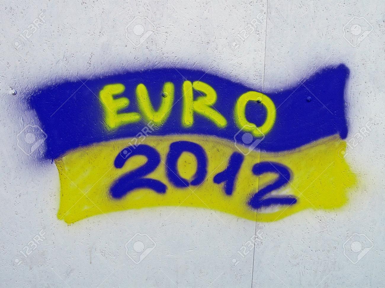 KIEV, UKRAINE - JUNE 19: Ukrainian flag with EURO 2012 text as graffiti on June 19, 2012 in Kiev, UKRAINE. EURO 2012 football championship started on June 08 in Ukraine, Poland.  Stock Photo - 14145925