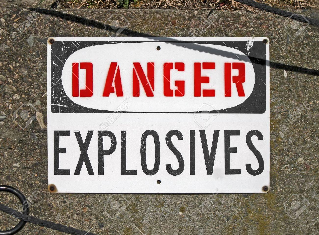 danger explosives, warning message on signboard, stress environment Stock Photo - 14656295