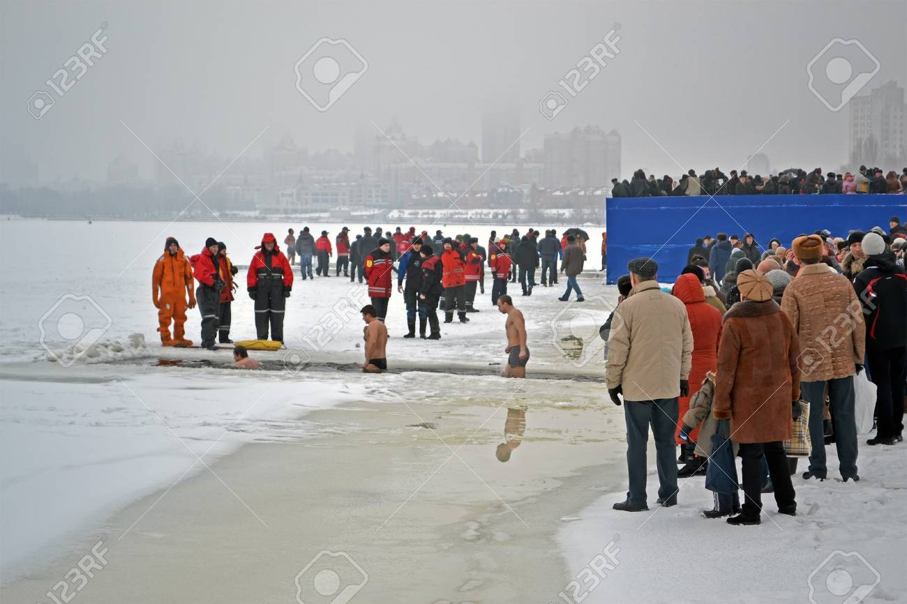 KIEV - JAN 19: Epiphany (Kreshchenya) morning on January 19, 2013 in Kiev, Ukraine. People plunging into ice-cold water three times as it helps body became more resilient to illness. Epiphany known since 988 AD. Stock Photo - 17437182