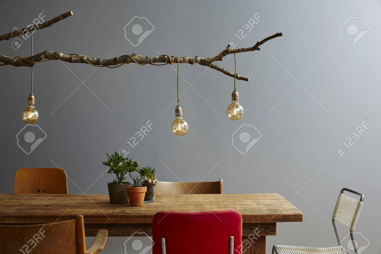 Modern Dinner Table Variety Of Chairs Urban Design Tree Lamp Stock Photo    74272601