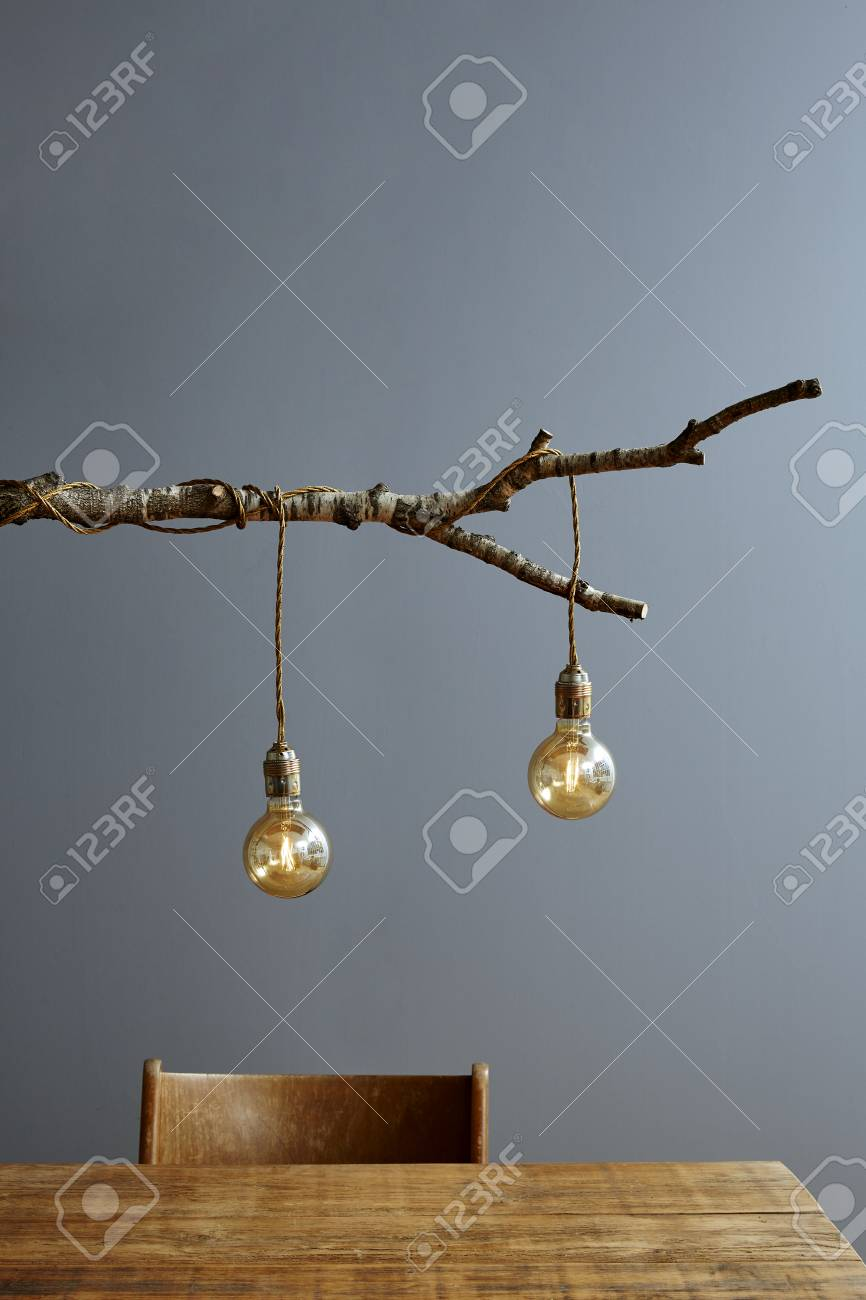 Urban Interior Wooden Table And Branch Lamp Stock Photo Picture