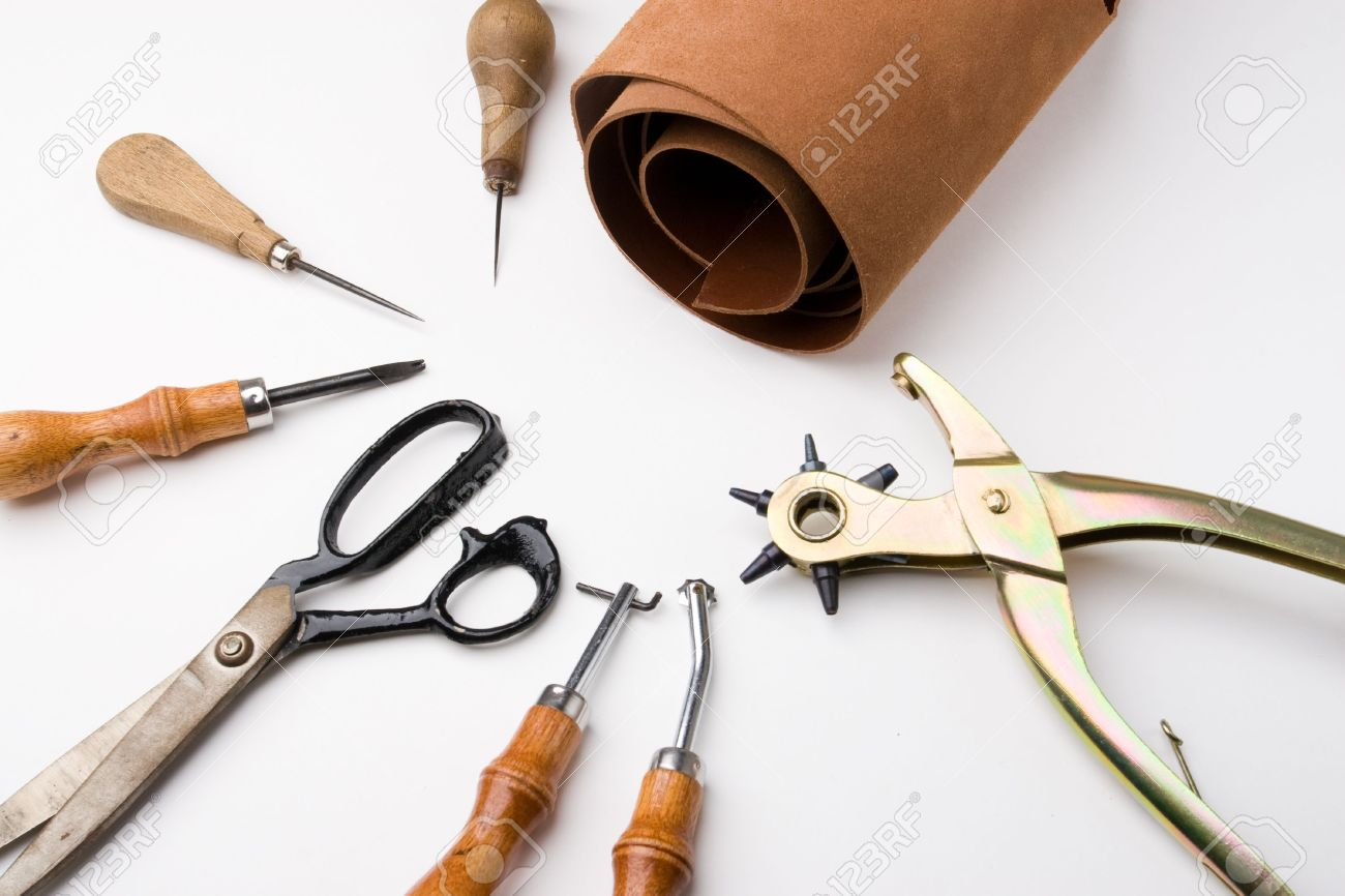 Some tools to work leather over leather background - 1797981