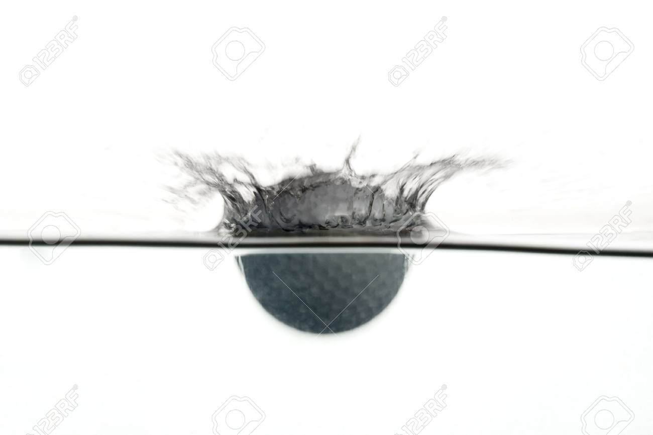 plunge in the water of a golf ball stock photo picture and