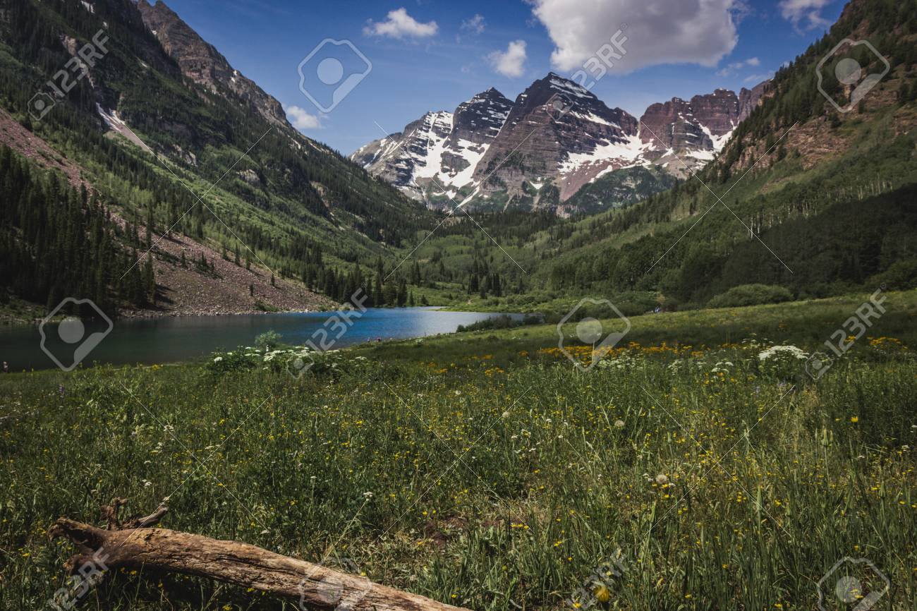 Majestic Maroon Bells Peaks And Maroon Lake On A Sunny Day And