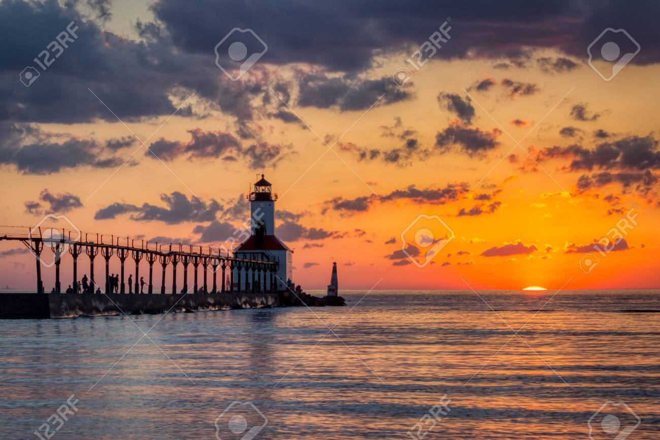 Stunning sunset with dramatic clouds over Michigan City East Pierhead Lighthouse, Washington Park Beach, Michigan City, Indiana - 124523808