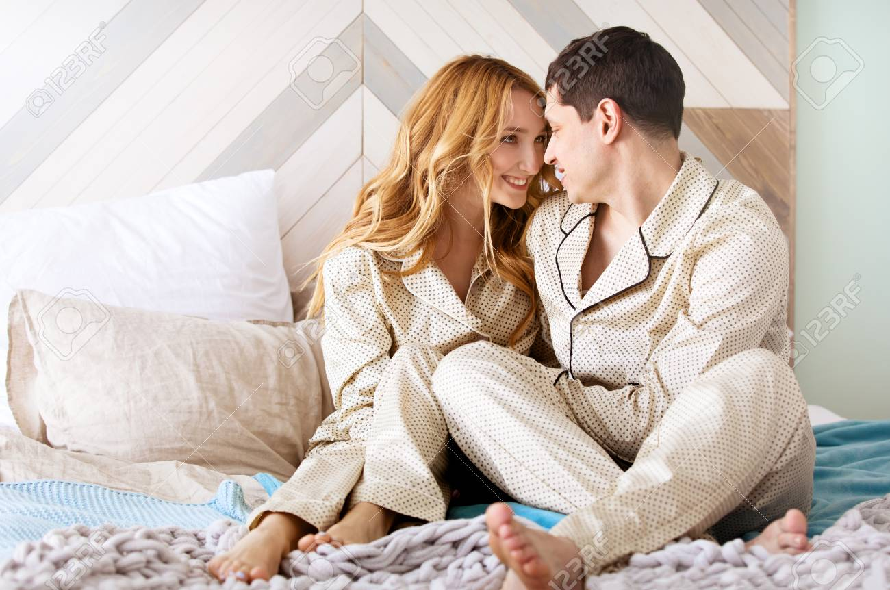 Loving Couple Wakes Up In The Morning Her Bed A Bright Interior Happy