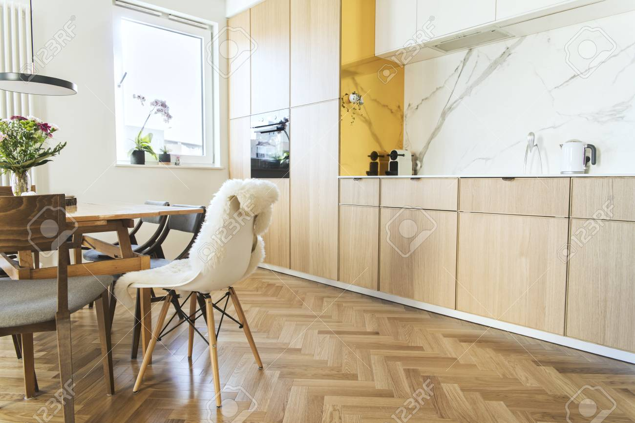 Stylish And Cozy Scandinavian Dining Room And Kitchen With Design Stock Photo Picture And Royalty Free Image Image 116987902