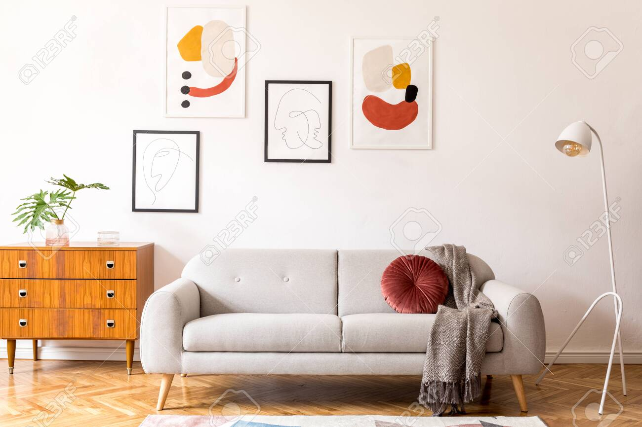 photo stylish vintage decor in a spacious flat interior with design grey sofa armchair retro mode and p