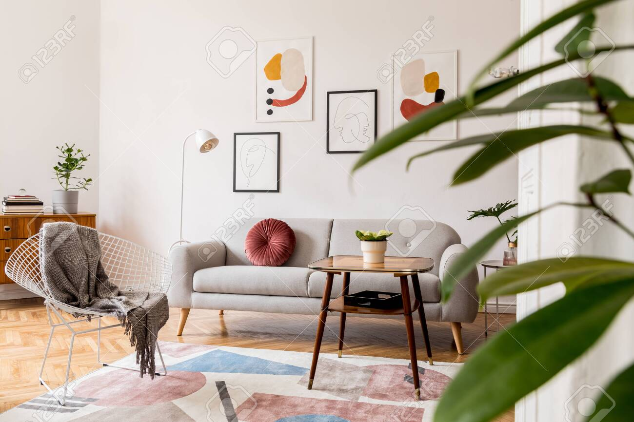 Minimal Retro Interior Design Of Living Room With Grey Couch