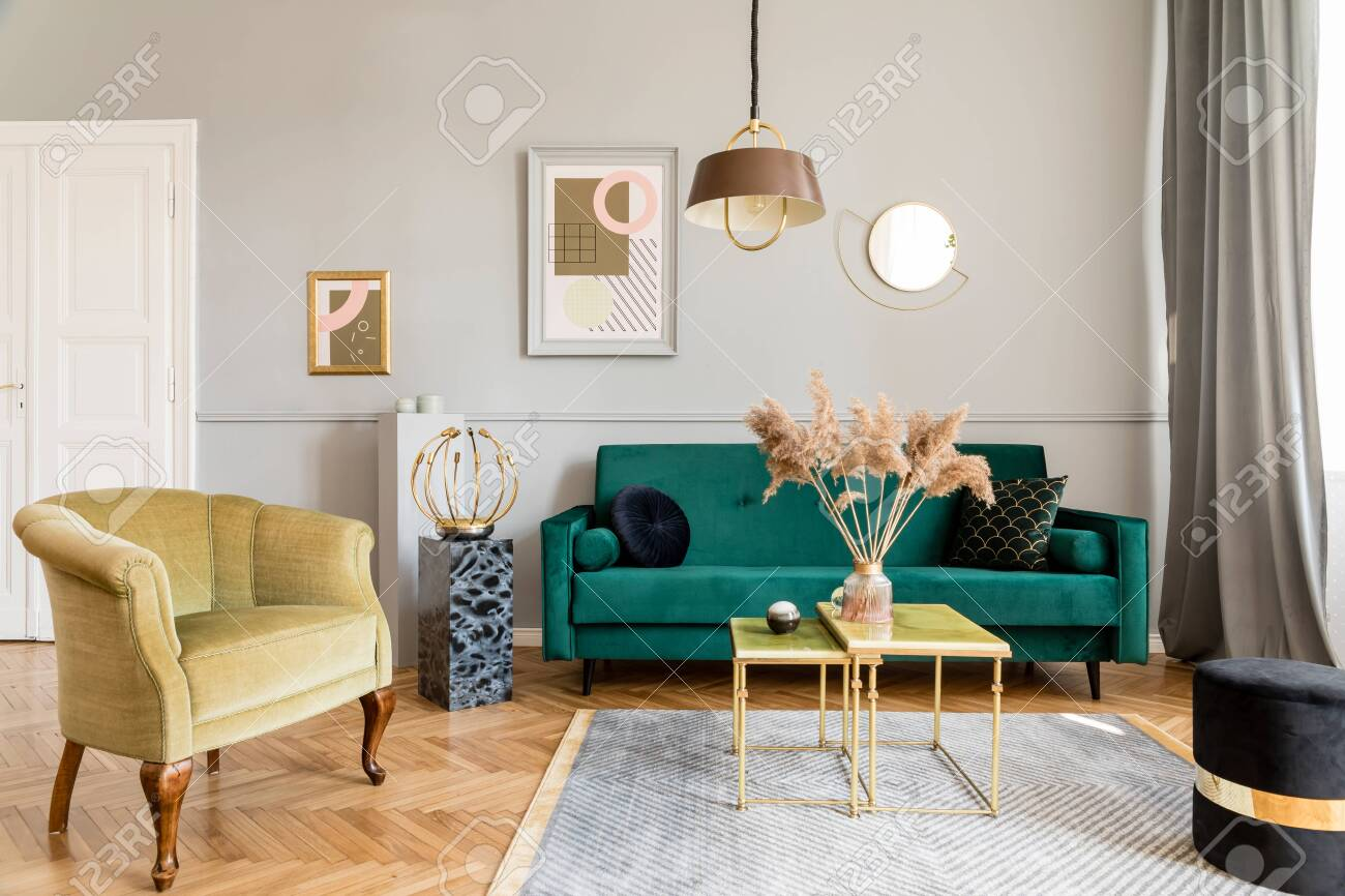 photo stylish and luxury living room of apartment interior with elegant green velvet armchair and sofa cof