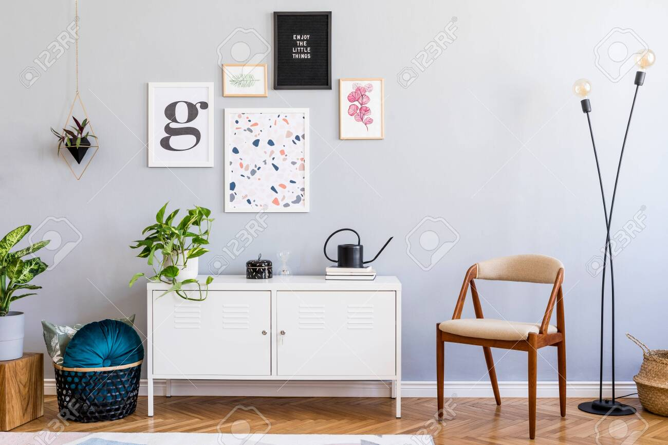 Stylish home interior of living room with mock up posters gallery wall, white shelf, design armchair, plants, flowers, lamp and elegant accessories. Gray background walls. Scandi home decor. Template. - 134013852