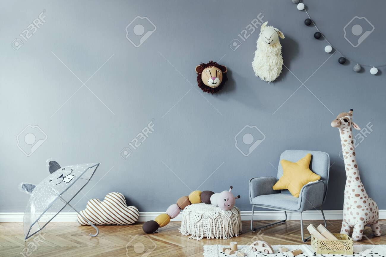 Stylish scandinavian newborn baby room with wooden cabinet, toys, children's chair, natural basket Modern interior with eucalyptus background walls, wooden parquet and cottona balls. Home decor. - 149636546