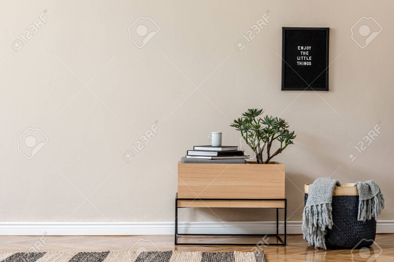 Interior design of living room at scandinavian apartment with stylish commode, tropical plants, books, tea pot and elegant accessories. Modern home decor. Template. Copy space. Beige walls. - 150701997