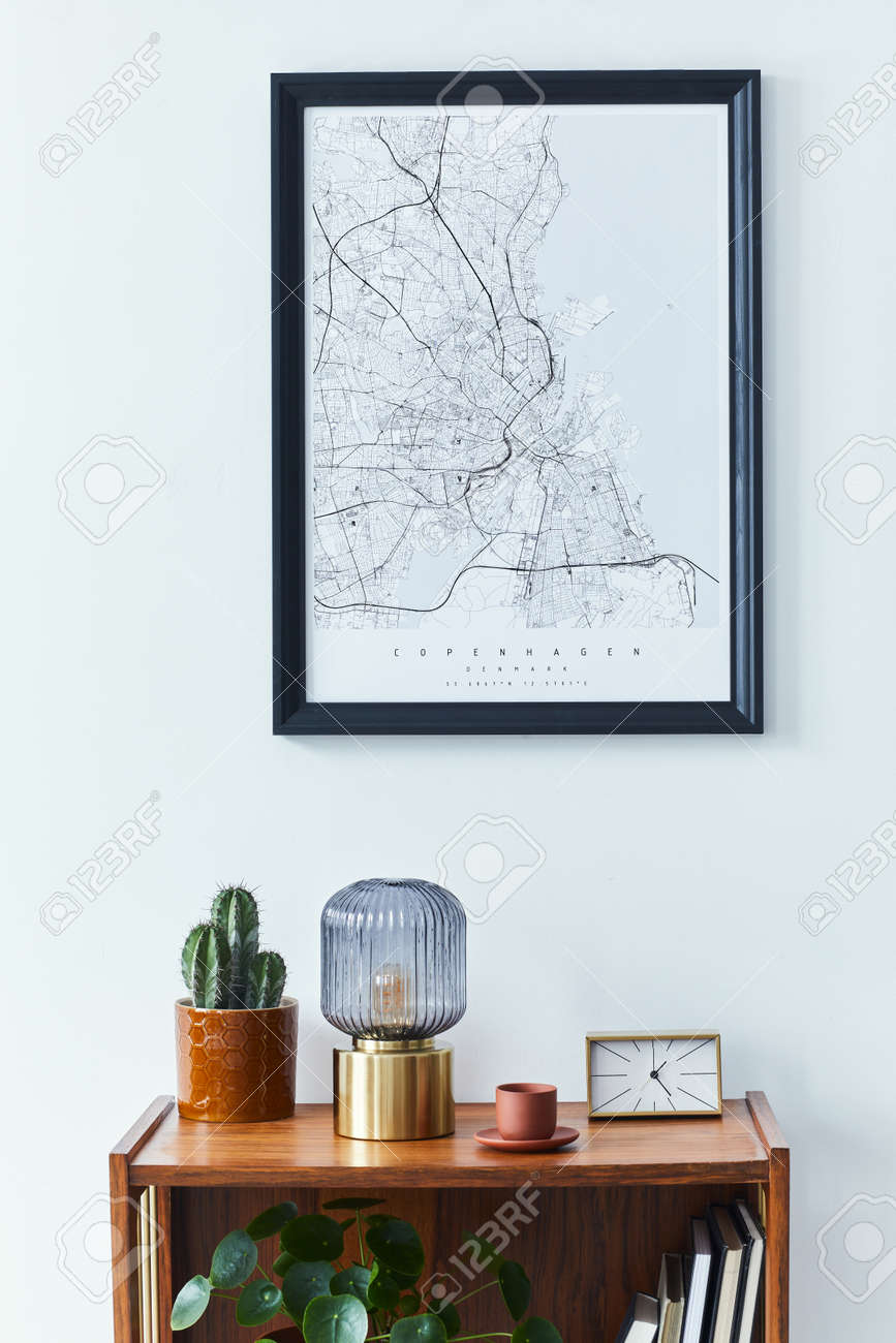 Stylish scandinavian living room interior with retro commode, black mock up poster frame, clock, plant, decoration, book and personal accessoreis in home decor. Template. - 168356325