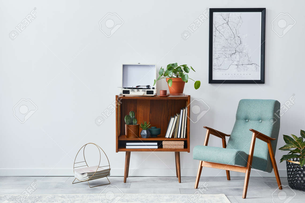 Retro composition of living room interior with mock up poster map, wooden shelf, book, stool, armchair, plant, cacti, vinyl recorder and personal accessories in stylish home decor. - 168356387