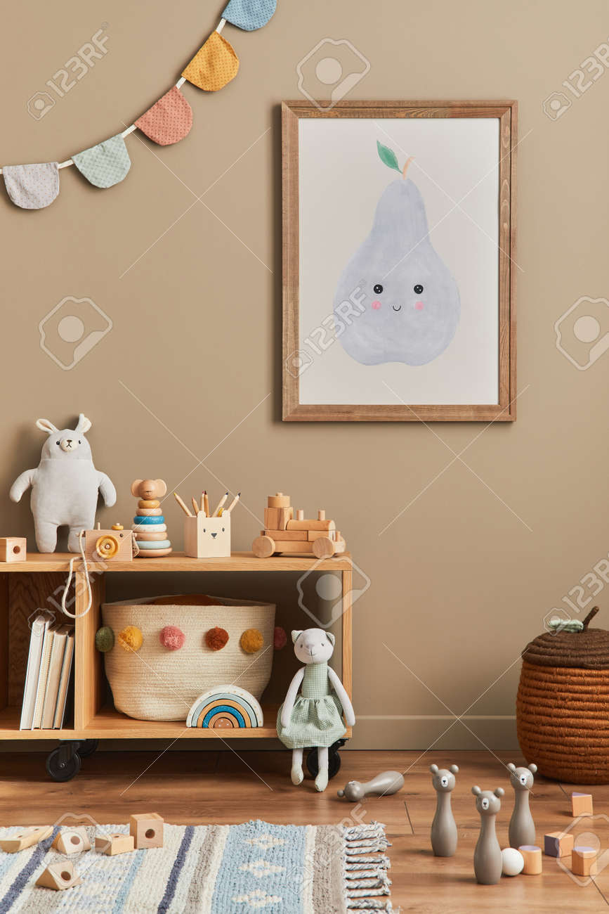 Stylish scandinavian newborn baby room with brown wooden mock up poster frame, toys, plush animal and child accessories. Cozy decoration and hanging cotton flags on the beige wall. Template. - 168356614