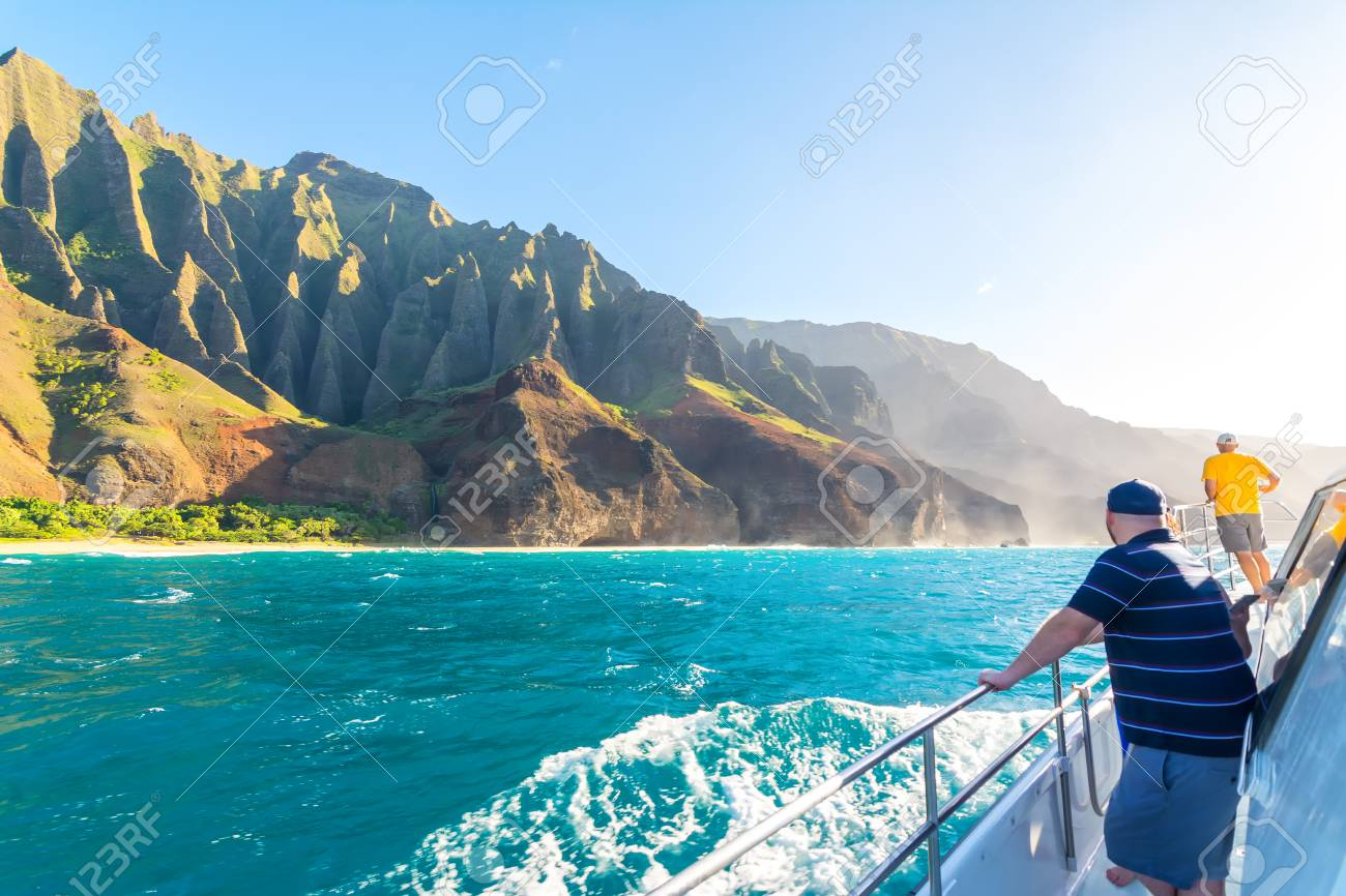 boat tour along na pali coast amazing at sunset, kauai island