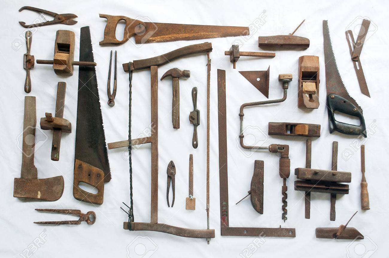 Collection Of Antique Woodworking Tools On White Cloth Stock Photo ...