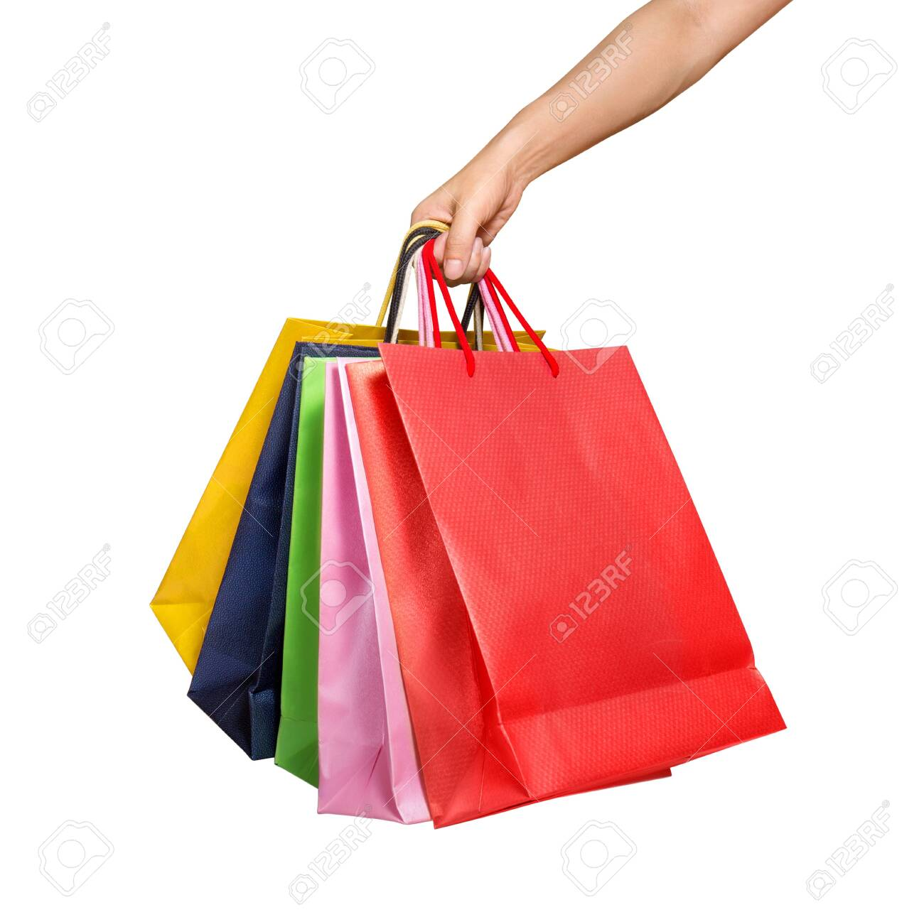 A Woman Hand Carrying A Bunch Of Shopping Bags Isolated On White Stock Photo Picture And Royalty Free Image Image 130110205