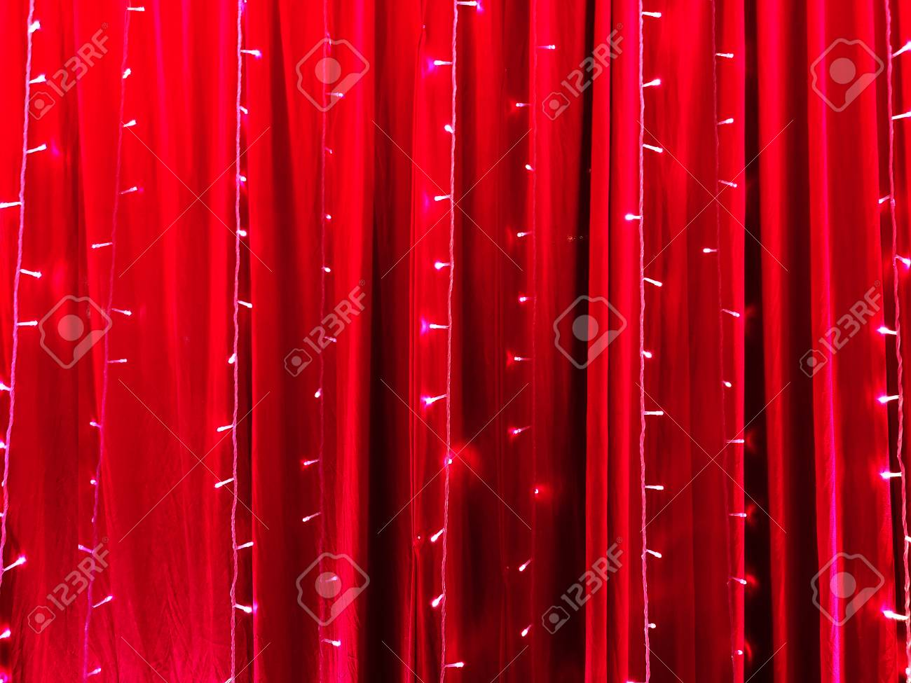 LED lights on red certain fabric backdrop as abstract background. - 126568667