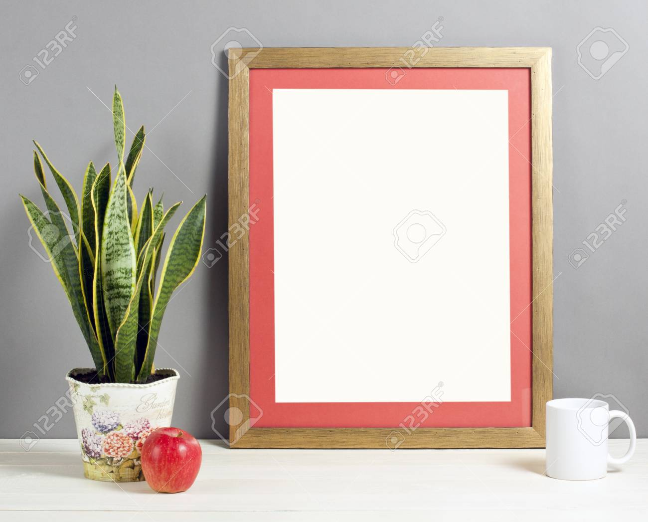Brown Frame Mockup With Plant Pot, Mug And Apple On Wooden Shelf ...