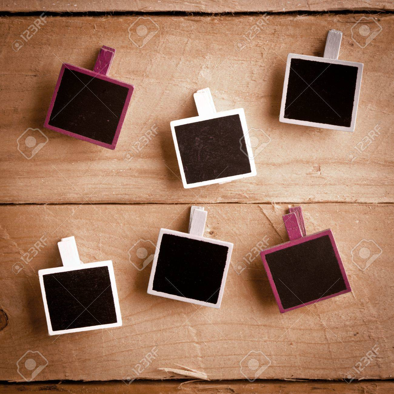 Six Squary Polaroid-style Photo Frames On A Wooden Background Stock ...