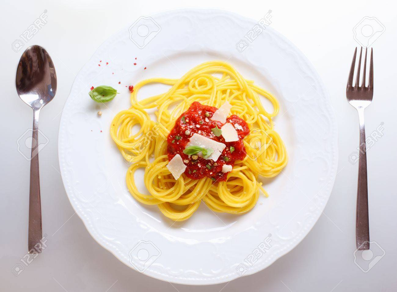 Plate of freshly prepared spaghetti bolognaise with a tomato sauce and cheese ready to be served. Stock Photo - 12300927