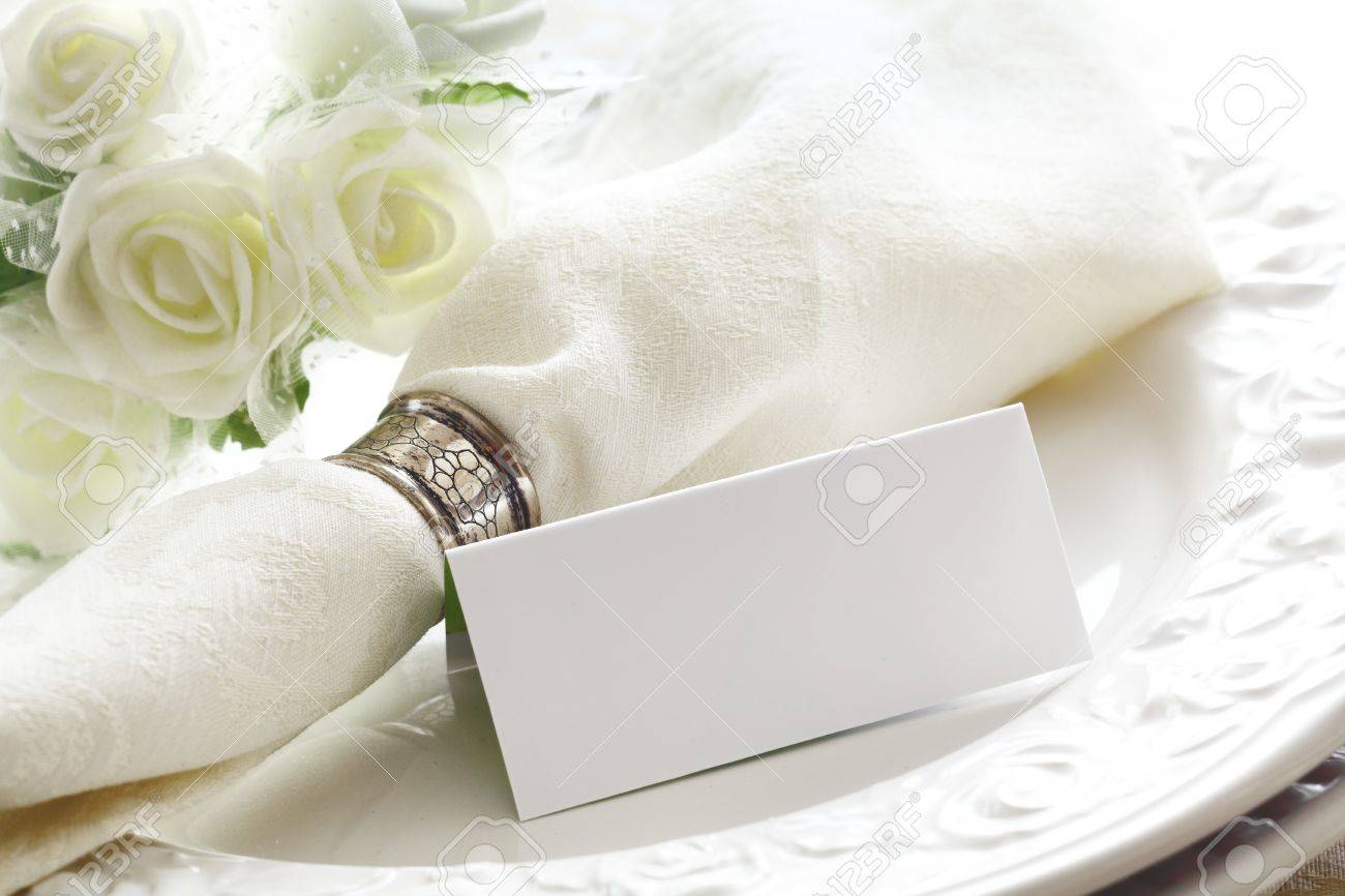 Elegant white Wedding place setting with beautiful white roses and a blank card Stock Photo - 12640324