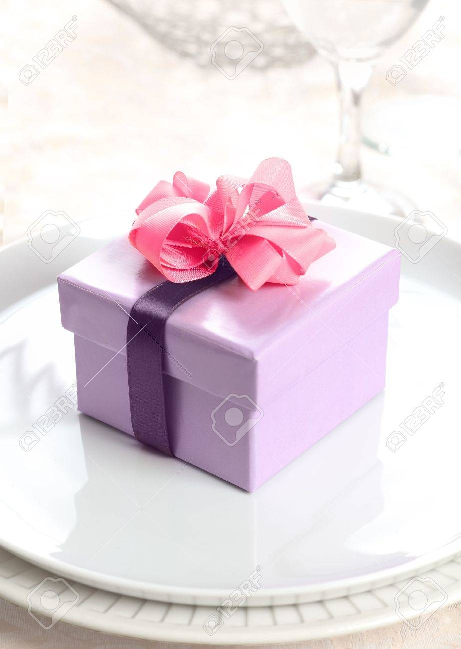 violet Present or Gift Box with a pink bow and a lilac ribbon Stock Photo - 12640346