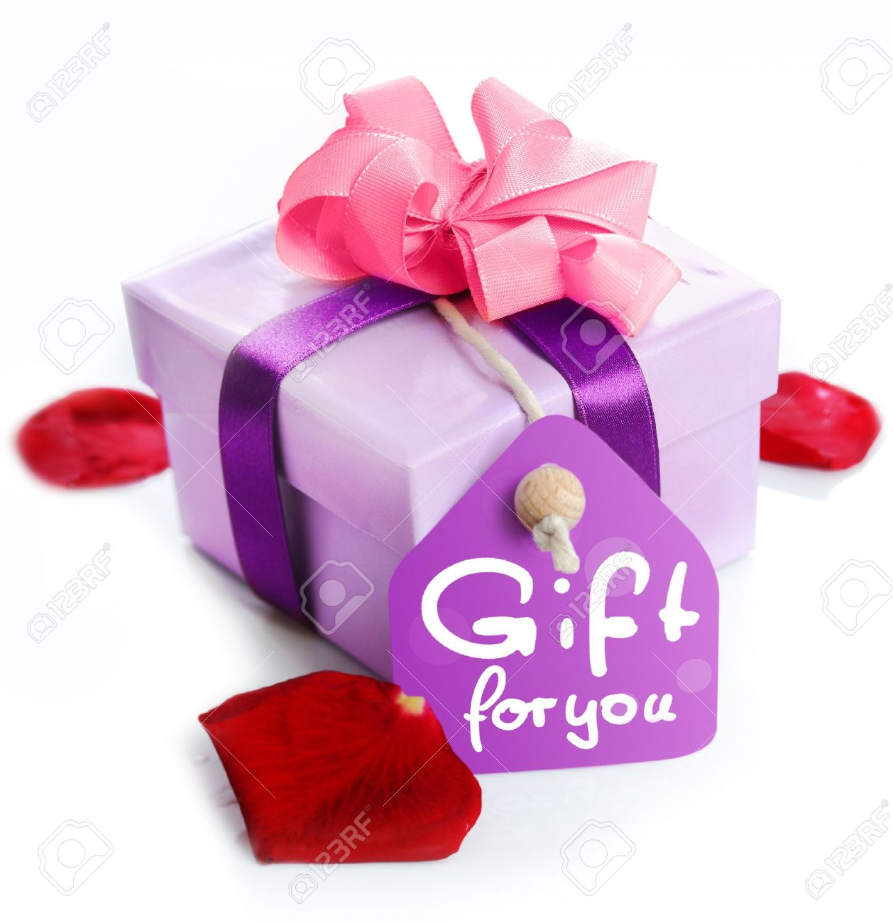 violet gift box with a card a ribbon and the words gift for stock