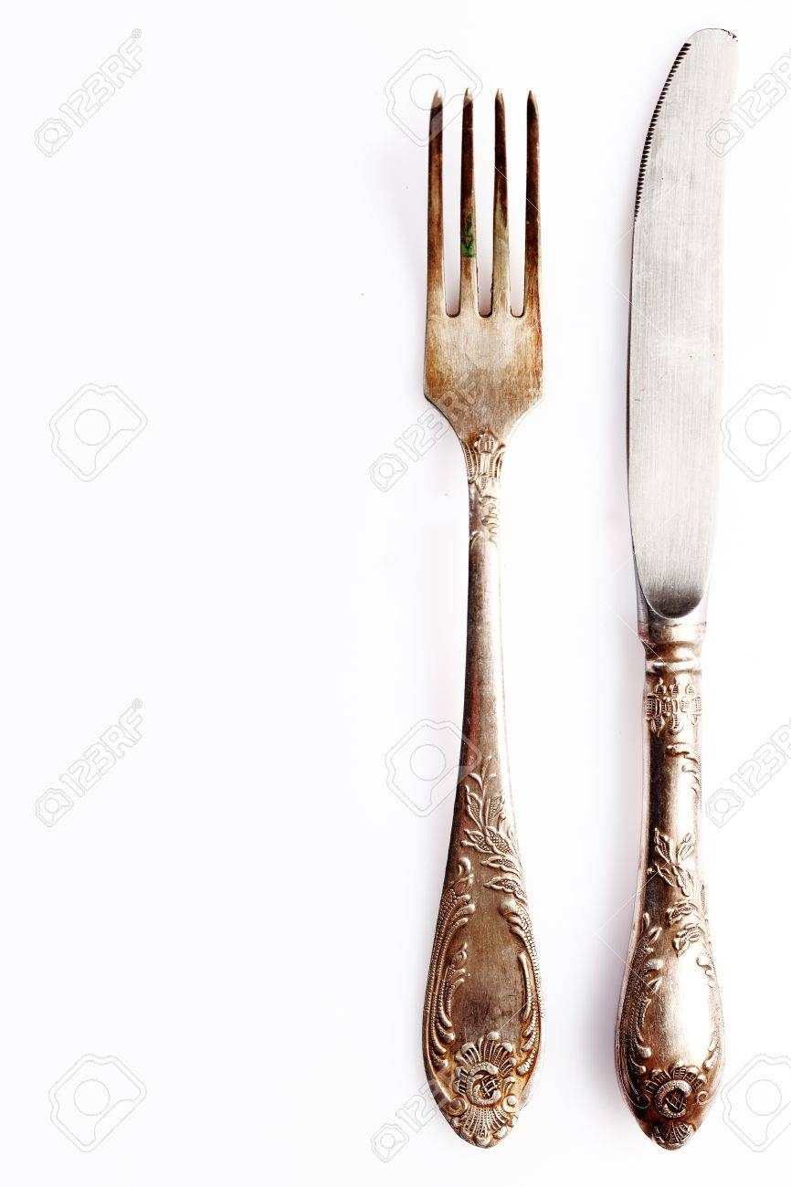 Silver cutlery setting comprising a knife anf fork on white with empty placement space for your  sc 1 st  123RF.com & Silver Cutlery Setting Comprising A Knife Anf Fork On White With ...
