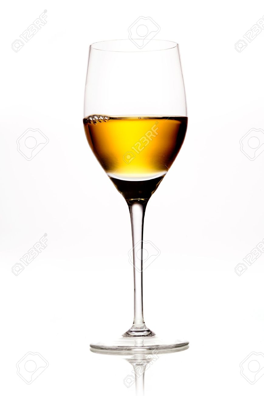 Elegant wineglass full of amber coloured wine or sherry on a white background with reflecton Stock Photo - 15394056