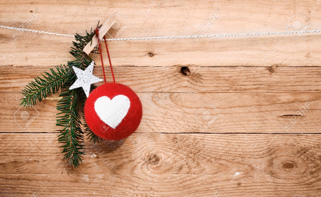Country Christmas Decorations With A Red Handcrafted Fabric Bauble Decorated  With A Heart, A Star
