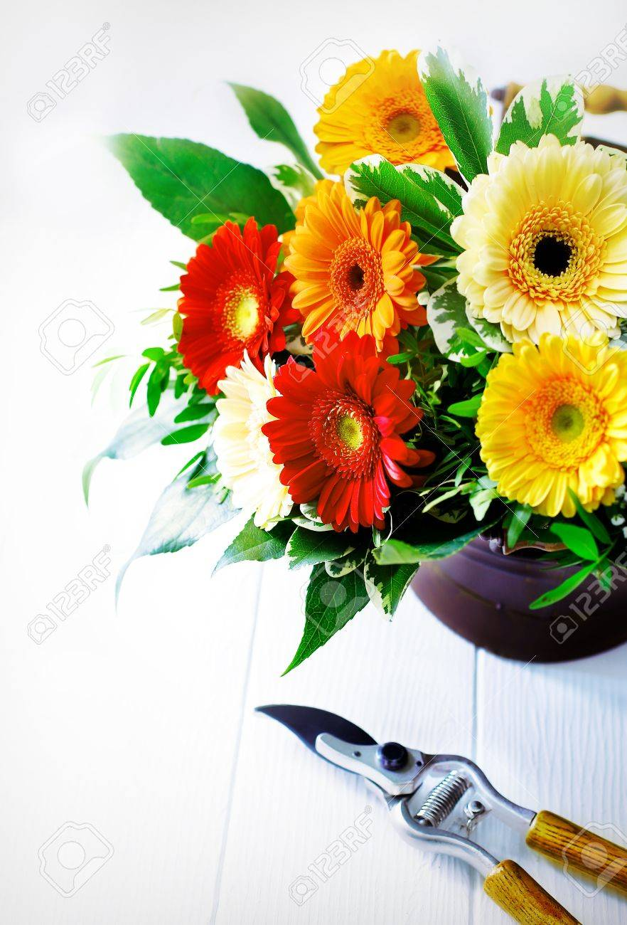 Colourful Flower Arrangement Of Bright Vivd Red Orange And Yellow