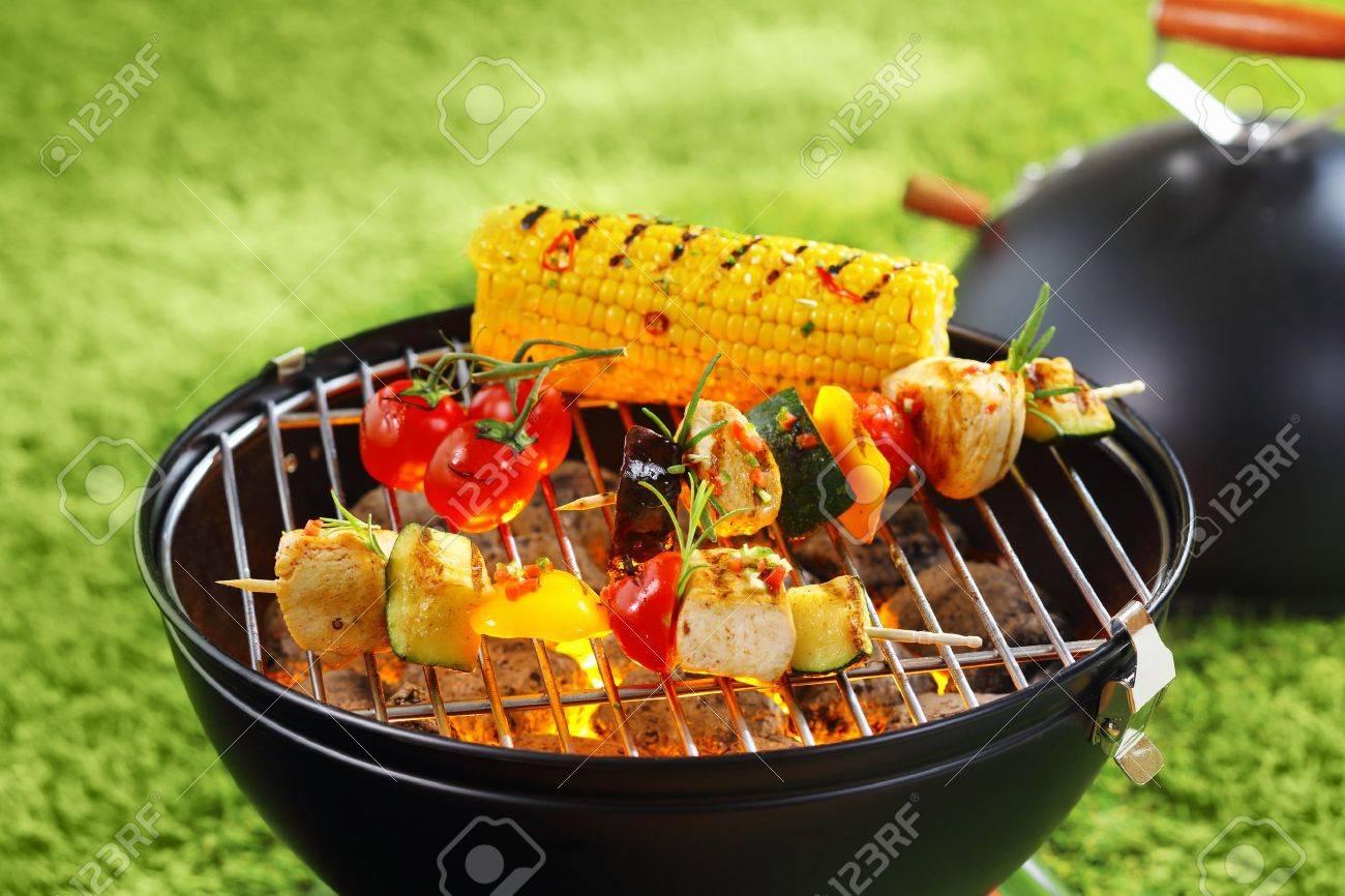 Healthy corncob en brochette on the grill outdoor Stock Photo - 18995314