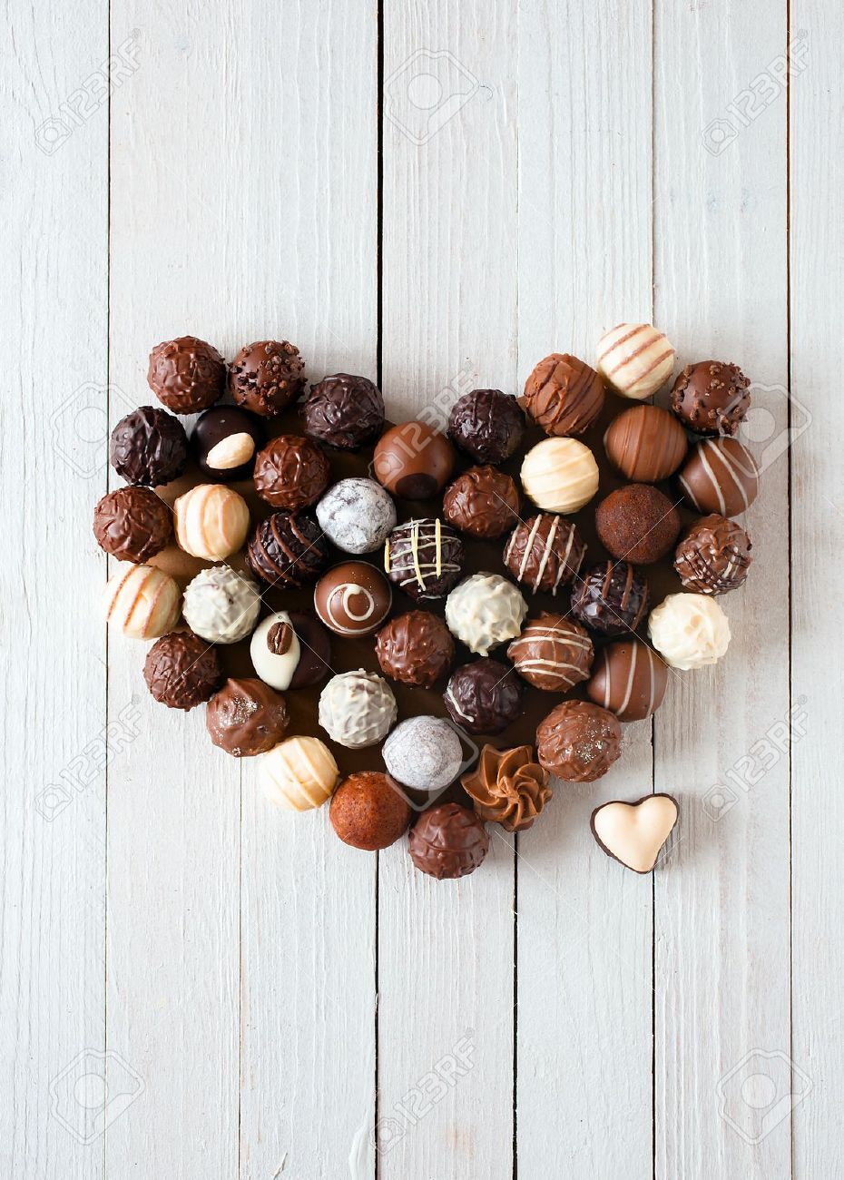 Heart Shape Made With Various Types Of Chocolate Truffles Over ...