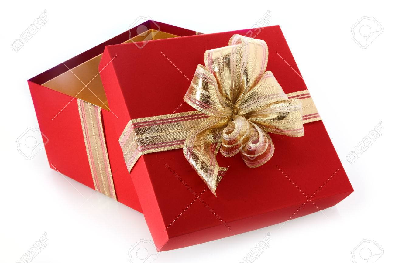 Open gift box with tilted lid and decorative gold ribbon and stock open gift box with tilted lid and decorative gold ribbon and bow for celebrating christmas negle Image collections
