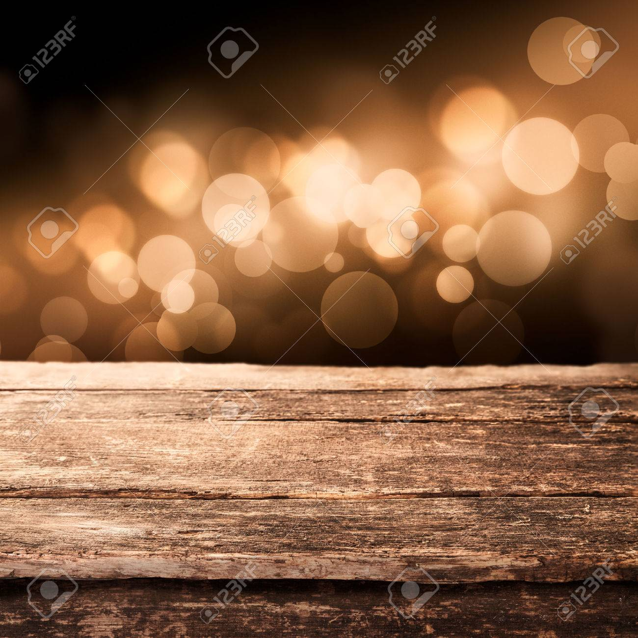 rustic: Old weathered wooden board or rustic table top with a sparkling  bokeh of golden