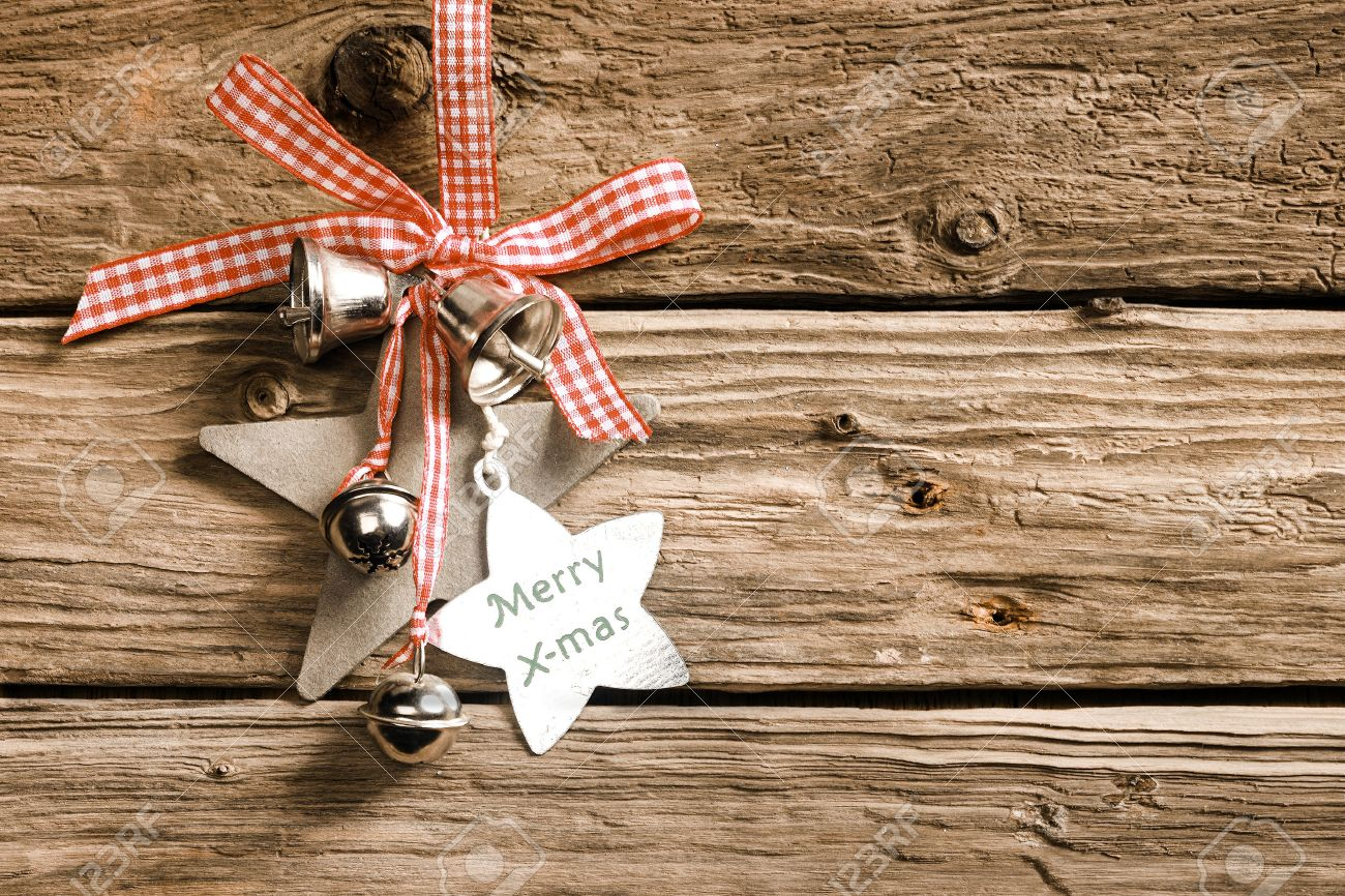 Rustic Decorative Christmas Background On Weathered Wooden Boards With A Pretty Dainty Red And White Checked