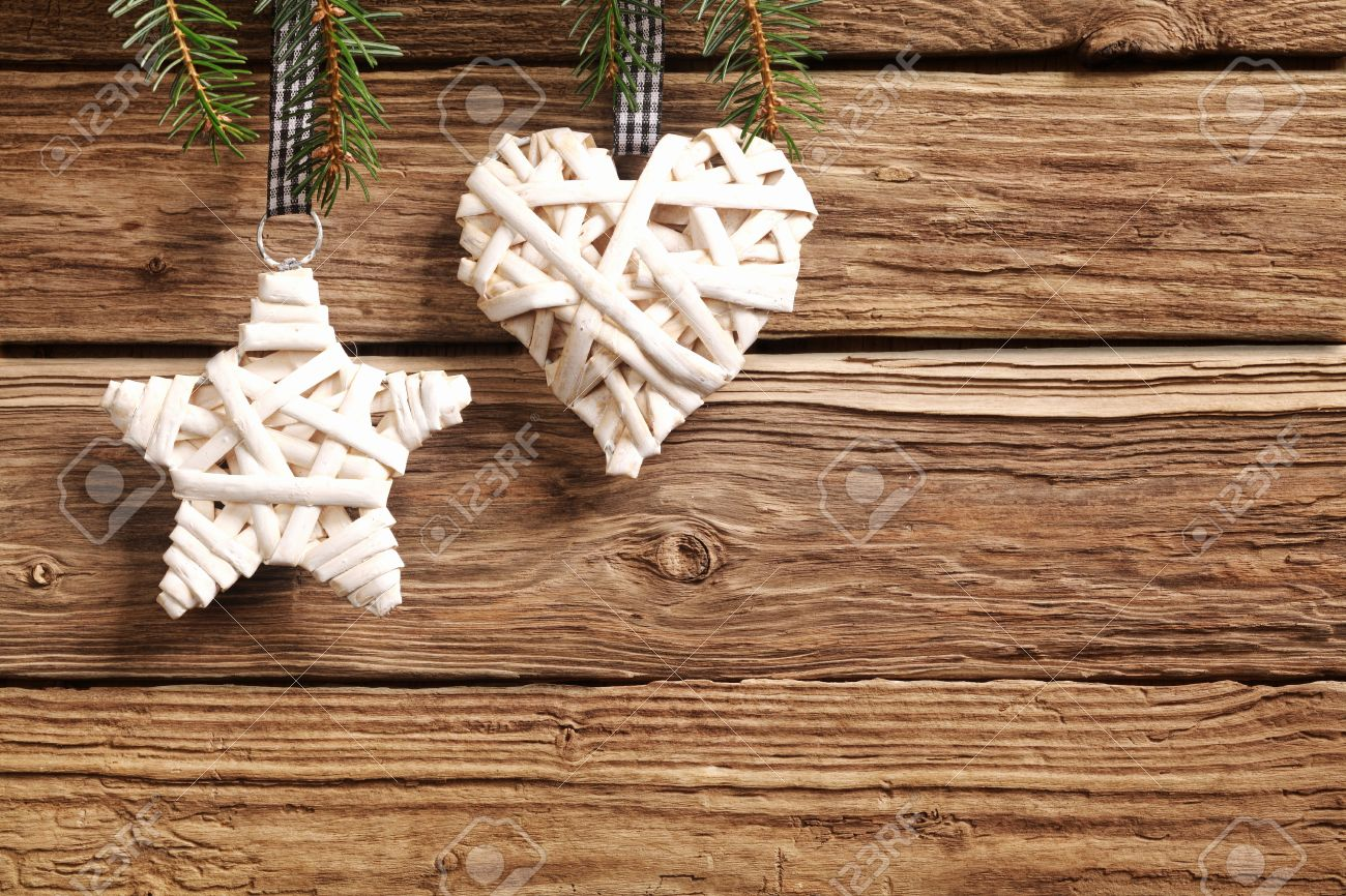Two Rustic Straw Christmas Ornaments On A Textured Wooden ...