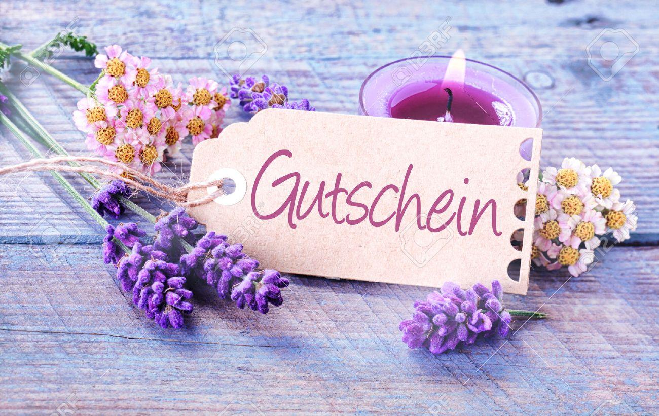 Spa wellness gutschein  Geschenkmarke Mit Dem Wort Gutschein In Deutsch Auf Hellblauem ...