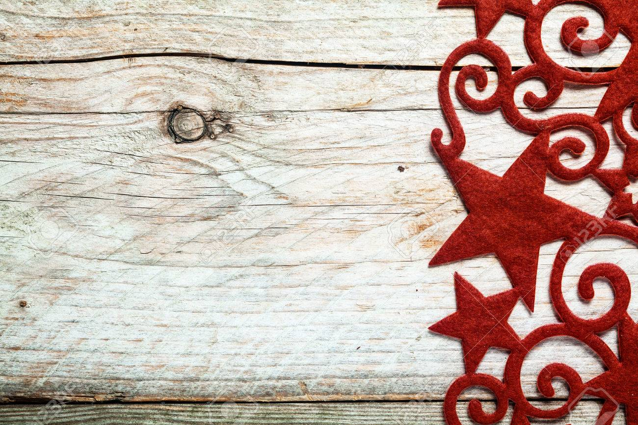 Decorative Red Star Christmas Border With Curlicues And Swirls On The Right Side Of A Rustic