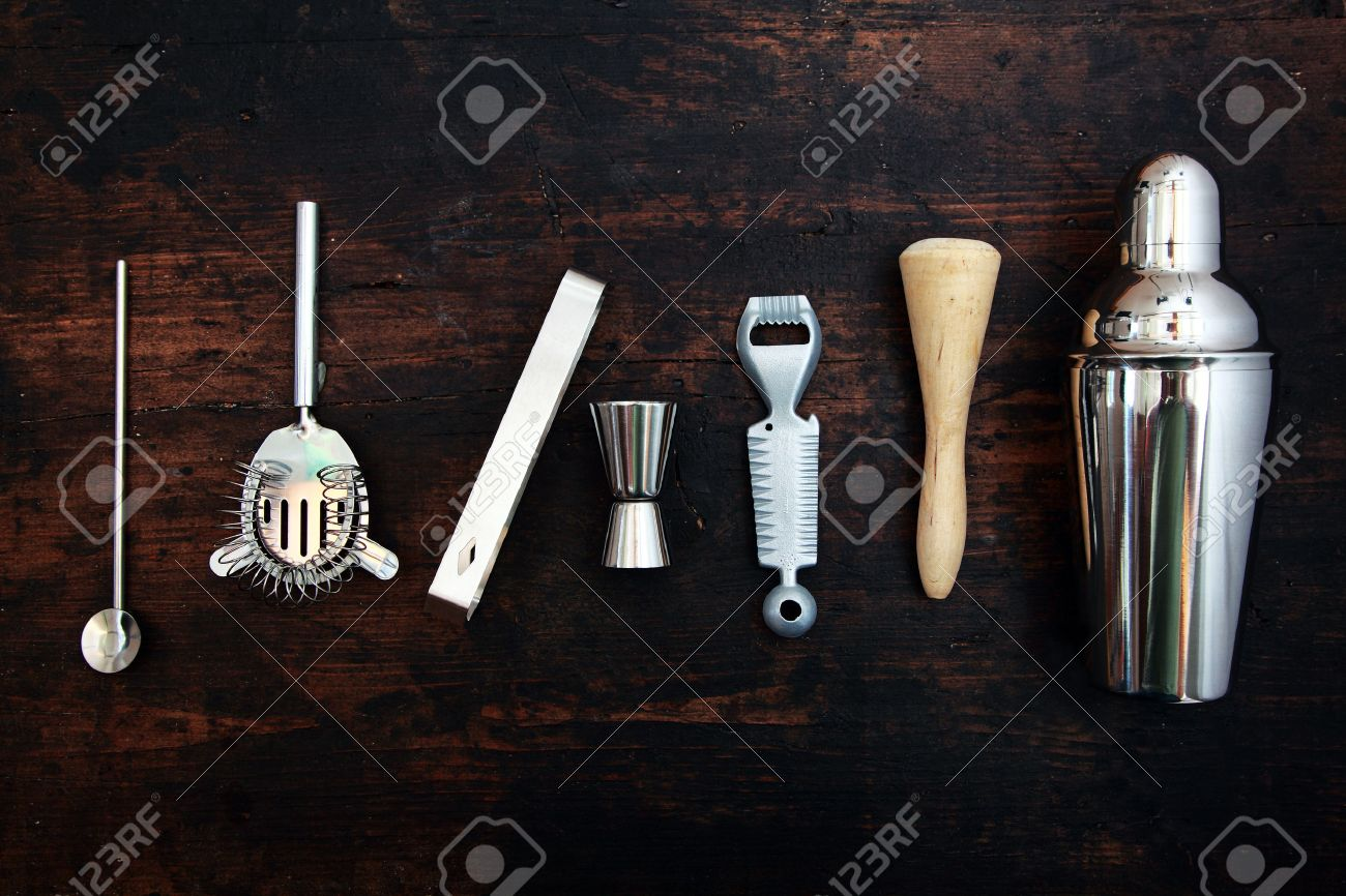 set of bar or pub accessories with a martini cocktail shaker stock