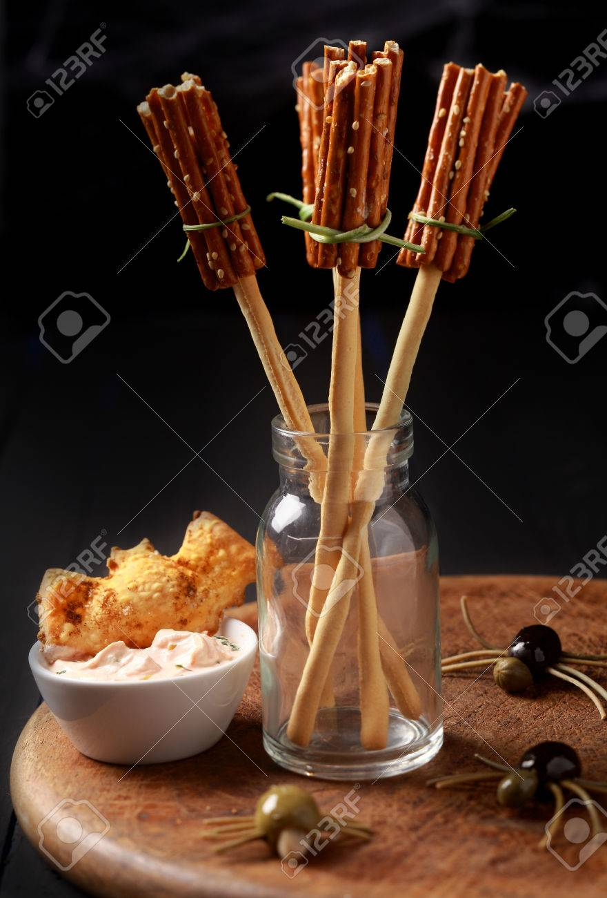 Creative Halloween Snacks And Appetizers With Witches Broomsticks Made From Bread Sticks Pretzels Creepy