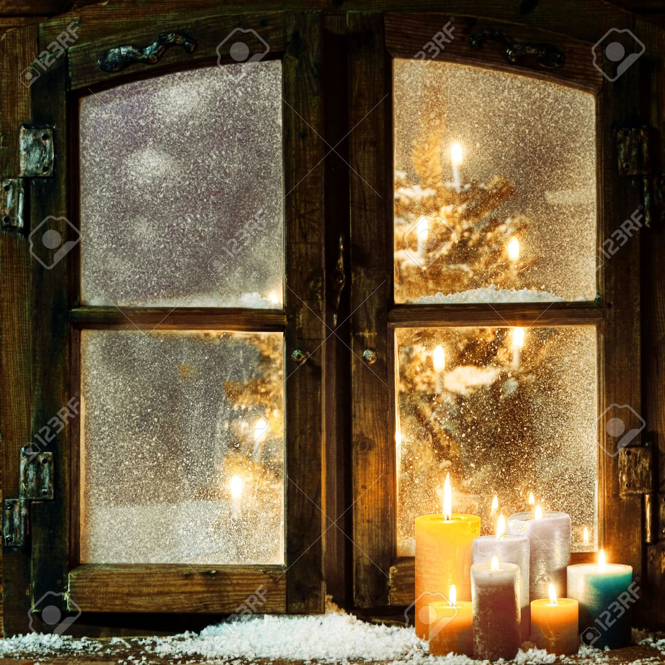 candlelight welcoming christmas window in a log cabin with a group of burning candles on - Christmas Candle Lights For Windows