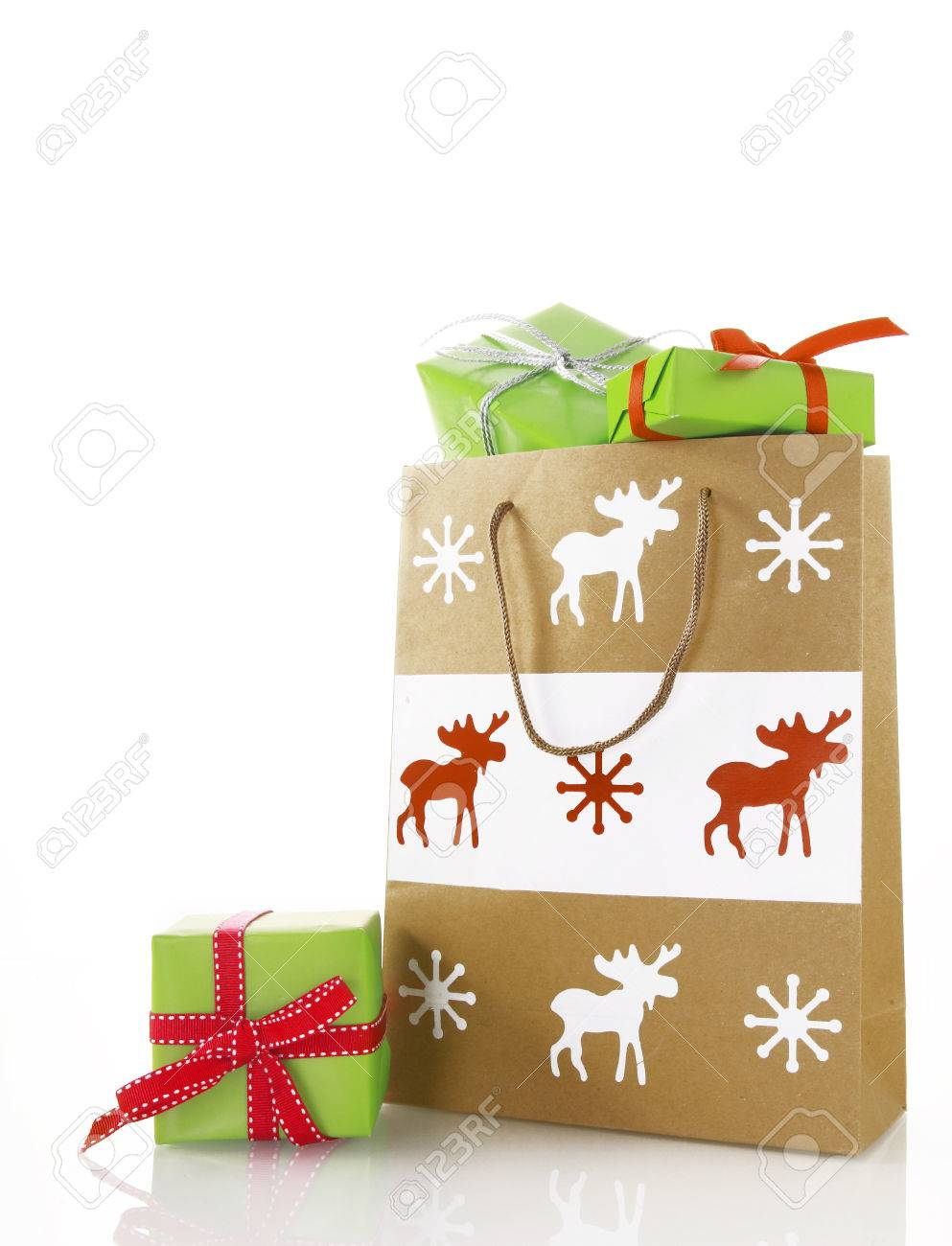 Close Up Brown Paper Bag With Apple Green Christmas Presents ...