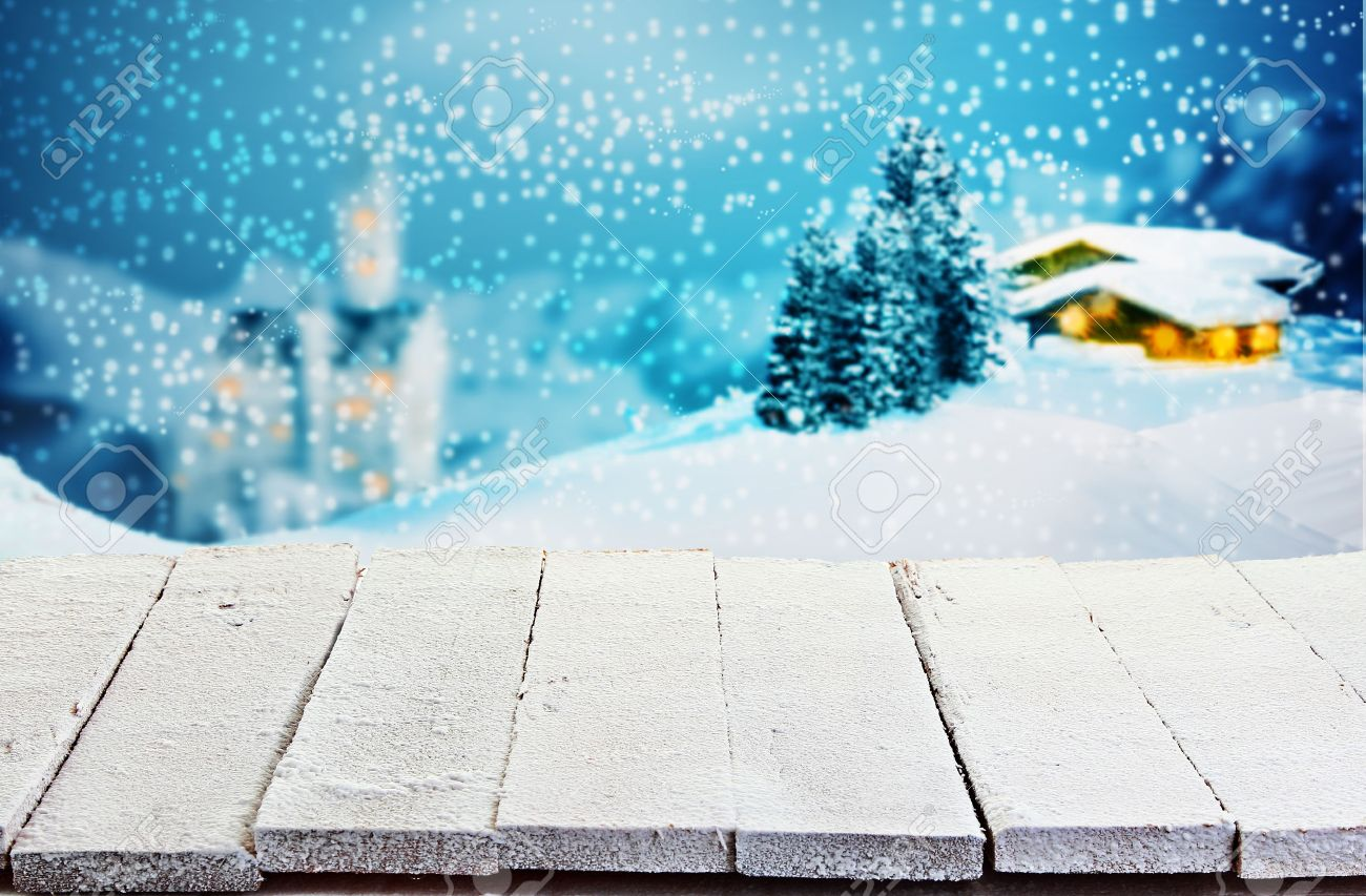 Empty Rustic White Painted Wooden Table With Rough Boards Against A Winter Christmas Scene Of